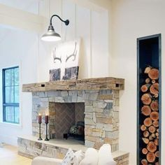 28 Stylish Stairway Decorating Ideas for Displaying Everything from Plants to Pictures - The Trending House Cabin Fireplace, Rustic Fireplaces, Fireplace Remodel, Fireplace Surrounds, Fireplace Design, Shiplap Fireplace, Stacked Stone Fireplaces, Above Fireplace Ideas, Farmhouse Fireplace Mantels