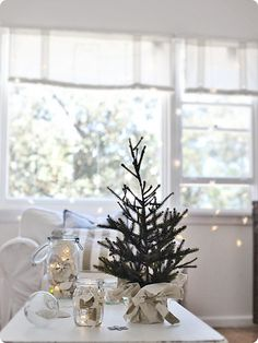 Coastal Christmas Decor. Love the little tree and lights in jar of shells.