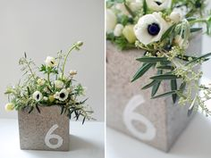 Cement block with flowers doubles as centerpiece and table number - unique and interesting.  Not gonna lie, I kinda love this.