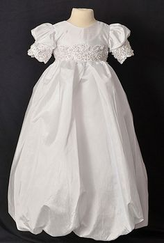 Absolutely stunning in quality and design. Poly shantung gown with cap sleeves. You must enlarge the picture to see the ornate, heavy beaded lace on sleeves and waistline. Your little angel will look like royalty in this gown. The Sweetie Collection uses only the finest imported fabrics, embroideries, beadwork and lace. Items are special ordered directly from the manufacturer. Please check this before ordering to ensure enough time before event and sizes and color are correct on your order.