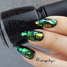 Broken-Glass Nail Design: Stiletto nails are in. Broken-glass nails are in. What does that mean? Stiletto broken-glass nails of course! If you want a super quick way to revitalise your nails or just don't have time to head to the salon, use the glass-effect to cover the chips and dents! You're covering up a multitude of sins technically so you can give yourself a little bit longer between salon-appointments too.