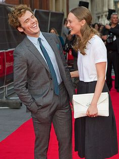 Star Tracks: Wednesday, April 2, 2014 | WHAT'S SO FUNNY? | Sam Claflin gets some support (and a good laugh!) from wife Laura Haddock at Tuesday's London premiere of his new horror film, The Quiet Ones.