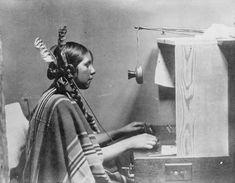 Helen, a Native American telephone & switchboard operator, working at Many Glacier Hotel, Babb, MT. 1925.