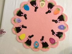Easter Egg Hunt  Sizzix die cuts, embroidery stitches on felted wool applique.