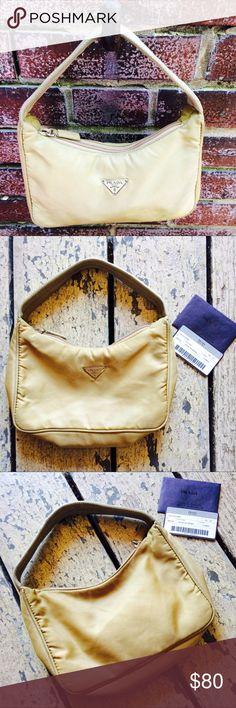 PRADA Tessuto Sport Camel Handbag PRADA TESSUTO SPORT Handbag with certificate of authentication. Zipper closure. Nylon material. Interior pocket. Inside is clean. Exterior has a couple spots nothing major (see pics). Camel color. Prada Bags Mini Bags