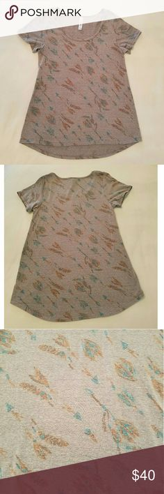 LuLaRoe feather arrows UNICORN Adorable feather arrows print shirt. In good used condition. Light pilling but it is a  distressed style.   Photo 3 shows the color the best (sorry for the horrible lighting)   No trades please  Will consider reasonable offers LuLaRoe Tops Tees - Short Sleeve
