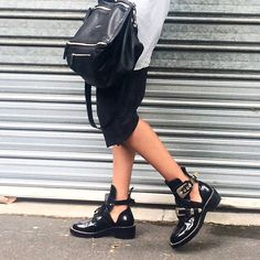 Still love these cut out boots. #balenciaga #givenchy #momentsofspur #Padgram