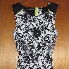 """Maurice's Black and White Print Dress with Lime XS Maurices black and white print dress with lime green trim.  Sleeveless - size XS.  Made in China.  Has elastic waist - has belt loops but no belt.  Buttons up the back.  In excellent condition.  Measurements: Chest:  16""""  across the front Waist:  10-15"""" across the front Hips:  16""""  across the front Total Length:  34.5"""" Maurices Dresses"""