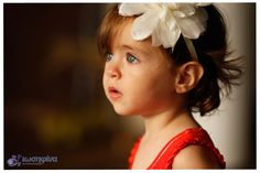 a little girl with flower-Portrait photography by Iosifina