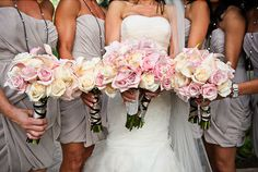 Pink and cream wedding flowers. Roses, cymbidium orchids, callas lilies.