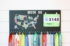 Running all 50 states in the US??? This is a fantastic way to showcase your medals & bibs and keep track of what states you have run. Comes with 50 hooks!!! Painted with black chalkboard paint. Crayola colored chalk included (because we are awesome like that). If you are worried about the chalk smearing (I have kids. I understand!), you can purchase liquid chalk markers instead (I would suggest Amazon.com, craft stores, or Walmart/Target). If you would like the heading to say somethi...