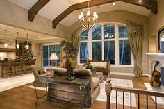 Loving the large window and wood beams in this traditional great room design! #greatrooms www.HomeChannelTV.com