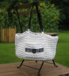 This bag works up quickly using 3 strands of yarn held together and a large hook.