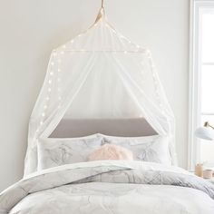 Add a magical touch to your sleep space with this enchanting canopy. It features color-changing lights for a whimsical look and fanciful feel. Pottery Barn Teen Rectangular Light Up Fairy Light Canopy Canopy Over Crib, Canopy Lights, Light Canopy, Led Shop Lights, Dorm Essentials, Color Changing Lights, Beds For Sale, Pottery Barn Teen