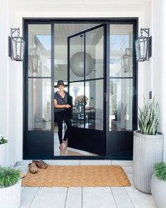 Incredible modern farmhouse entry / exterior with glass and iron door designed by featuring the Darlana Small Tall Bracketed Wall Lantern by Chapman & Myers. Modern Entrance, Modern Front Door, Modern Patio Doors, Modern Garage Doors, Modern Porch, Contemporary Front Doors, Modern Windows, Entrance Design, Design Room