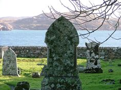 Graveyard at Iona Abbey in the Western Isles of Scotland - stones and the serene view out to sea, across to the Isle of Mull.