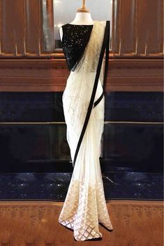 Nylon Mono Net Saree In White And Black Colour White And Black Colour Nylon Mono Net Fabric Party Wear Saree Comes with matching blouse. This Saree Is crafted with Thread Work,Sequins Work This Saree Comes with Unstitched Blouse Which Can Be Stitc. Net Saree Blouse, Sari Dress, Saree Blouse Designs, Black Saree Blouse, Black Net Saree, Modern Blouse Designs, Black And White Saree, Black Blouse Designs, Lace Saree