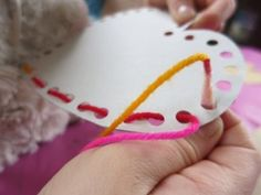 Threading around holes in cardboard will develop fine motor skills whilst making great hanging decorations for either at home or in the classroom!