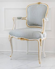 The Louis XV style Regent Side Chair from Ave Home has gold leaf details that pair beautifully with the hand applied white finish. The upholstery can be kept its beguiling white or the piece can be custom upholstered, as shown here. Royal Furniture, Classic Furniture, Furniture Styles, Furniture Design, Vintage Dining Chairs, Dining Room Table Decor, Antique Chairs, Cowhide Chair, Diy Furniture Renovation