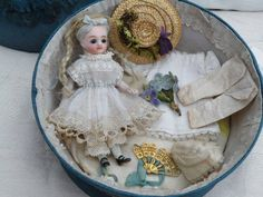 All Bisque Mignonette Doll In French Box with Trousseau from dollyweatherwax on Ruby Lane