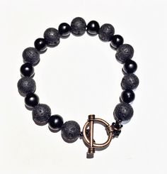 Handmade bracelet crafted from Black Onix and Lava Rock. Made by Unbound Essentials.