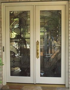 ArtGlassByWells | Contemporary custom leaded glass front entry doors in Houston, Texas. Beveled and textured glass used to create privacy in doorway.