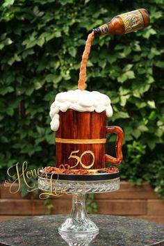 Gravity-defying birthday cake with fondant wood planks and handmade fondant pretzels.