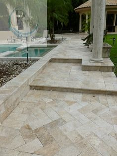 The look says it all! Stunning view all around utilizing impressive travertine marble pavers for this pool deck remodeling job. #travertinepavers #pooldeck