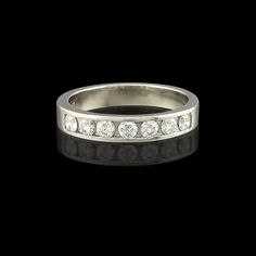 12ade1af6a3 wide platinum band totaling carats of channel set round brilliant cut  diamonds. Ring size is a 6 and is resizable. 66mint - Fine Estate Jewelry