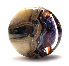 These incredible lampwork beads are by Canadian artist Sherry Bellamy. Description from dailyartfixx.com. I searched for this on bing.com/images
