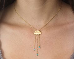 Rain cloud necklace  English Rain. Gold cloud necklace.  Turquoise rain necklace with tiny dangly turquoise rondelles chain necklace on Etsy, $38.94