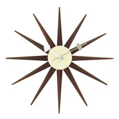 $89 Mid-Century Modern Reproduction Sunburst Clock - Walnut Inspired by George Nelson Clock size: 18.5 Dia x 2.5 D Material: Solid Wood and Metal Movement: Quartz