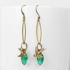 Our gorgeous antiqued style earrings are €18.95 from ArtySmartyShop.com. Hanging on an elegant hook these dainty hanging leaf shaped earrings are made from antiqued brass and a pretty Czech glass bead. Inspired by the #Irish countryside flora and fauna we have created thesecontemporary pieces. Hand made in our #Dublin studio.  #artysmartyshop #handmadejewellery #jewelery #natural #fashionaccessories  #giftidea #forher Dangly Earrings, Drop Earrings, Earrings Handmade, Handmade Jewelry, Leaf Shapes, Czech Glass Beads, Dublin, Antique Brass, Free Gifts