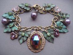 Cathedral Grove Charm Bracelet - Leaf Bracelet - Forest Jewelry - Glass Cameo Bracelet - Woodland Jewelry - Fairy Jewelry - Leaf Jewelry by SilverTrumpetJewelry on Etsy https://www.etsy.com/listing/208342719/cathedral-grove-charm-bracelet-leaf