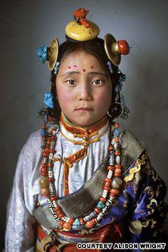 Tibet girl, Manigango, Kham, Tibet, 2005    http://travel.cnn.com/face-face-portraits-human-spirit-046291?iid=article_sidebar#