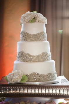 white fondant wedding cake decorated with edible silver balls