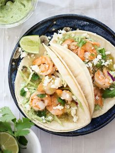 Shrimp Tacos with Garlic Avocado Crema #healthy #tacos #recipe