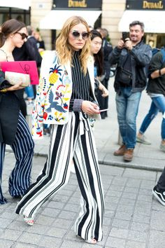 131 chic outfit ideas to copy from the street style scene at last week's Paris Couture Week: Olivia Palermo wears striped wide-legged pants and a floral blazer
