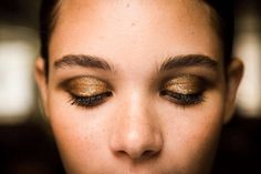 Spring Makeup Trend: Gilded Lids  At Jason Wu's show, Lancôme makeup artists smudged Le Crayon Khol in Black Coffee into creases and lined the top lashes with Jason Wu for Lancôme Artliner in Noir. Then the lids were given a wash of brown eyeshadow and topped with actual loose gold glitter for a stunning metallic effect. Try a metallic pigment to pull this off, like MAC Pressed Pigment in Damson, $21.