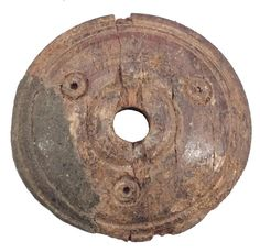 VIKING SPINDLE WHORL C.866-1067 A.D. Found in the York England area. 1 diameter with radial and concentric circle decoration. Made of dark horn or antler with distinct grain and a little delamination from age. Minor chips.