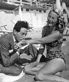 French actress Michele Morgan with artist and filmmaker Jean Cocteau on the beach during the Cannes Film Festival, 1946.