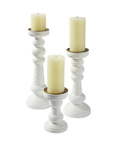 Sculptural and textural, these candlesticks make unique centerpieces and can dress up a mantel in no time flat. The whitewash finish has a light, beachy vibe we love.