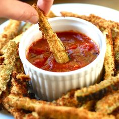 Baked Zucchini Fries 2 medium zucchini, sliced into sticks 1 large egg white ⅓ cup seasoned bread crumbs ¼ tsp. garlic powder (optional) cooking spray salt and fresh pepper