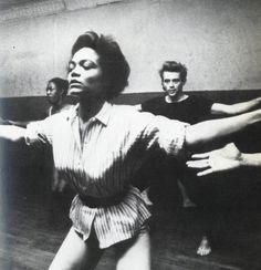 Eartha Kitt teaching a dance class with James Dean in the background.