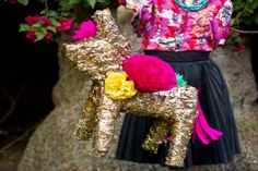 This pinata makeover is a great option for when there just isn't enough time to create one from scratch but you'd still like to have something unique at your party.