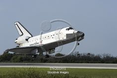 Space shuttle Discovery lands on Runway 33 at the Shuttle Landing Facility at Kennedy Space Center in Florida Canvas Art - Stocktrek Images x