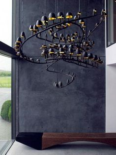 An edgy take on chandeliers might just steal the attention away from the dinner party.   Photo:  Eckmann Studio Blog