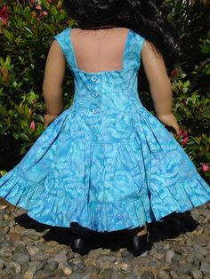 This is a RESERVED LISTING for momscoco. If you are not this person please do not purchase.    This is a beautiful blue ruffled dress with a coat and hat to match. The dress is made using a cotton Batik. It has a full ruffled skirt with a tulle underskirt attached to the lining. it closes in back with 3 real buttons. It is embellished with a double bow at the neck. The coat is made with a princess line and is fully flared. The coat and hat are made using a linen/rayon blend. They are ful...