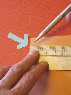 For anyone who likes creating things with paper, this is one of the best measurement shortcuts I've ever seen. I learned it in a bookbinding workshop led by Cherryl Moote. If you need to divide a rectangular sheet of paper into equal pieces, lay a ruler with the zero on one edge of the page. Slide the ruler down until a number divisible by the number of sections you need appears on the other edge of the paper. For example, I want to divide my 8.5 x 11″ sheet into 5 equal sections. I slide the ru