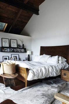 | white linen | wooden bed | black frames | - feelathomeinterior